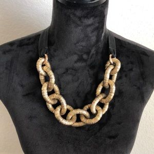 Dusty gold chain necklace.